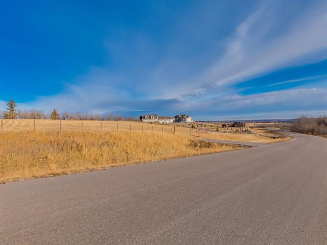 3.60 ACRES of BEAUTIFUL land close to Red Deer Lake + just off 37 Street in the STUNNING ROLLING COUNTRYSIDE of the RURAL FOOTHILLS MD, but only MINUTES to Calgary!  BUILD your DREAM HOME here, located in a QUIET CUL-DE-SAC in a the WILLOW VALLEY sub-division, on a LARGE PRIVATE lot w/some TREES + a DRILLED WELL!  VIEWS ALL AROUND of the GORGEOUS land w/WILDLIFE GALORE! JUST MINUTES to Spruce Meadows + the City limits w/ALL of its amenities CLOSE-BY plus QUICK + EASY ACCESS to ALL of Calgary w/the up + coming STONEY TRAIL ring road! Located justa  Short jaunt from the NEW GRANARY ROAD Farmers Market + Convenient Paved Road Access.  This REALLY is GREAT VALUE for the $$$ when you consider the POTENTIAL + GREAT LOCATION of this LAND! GRAB this FANTASTIC opportunity w/BOTH HANDS! TAKE a DRIVE OUT + YOU WILL NOT BE DISAPPOINTED!  GST is included in the Purchase Price.  Architectural Controls are in Place.   You can't find many parcels this close to the CITY on a PAVED ROAD!  Call TODAY for more details!