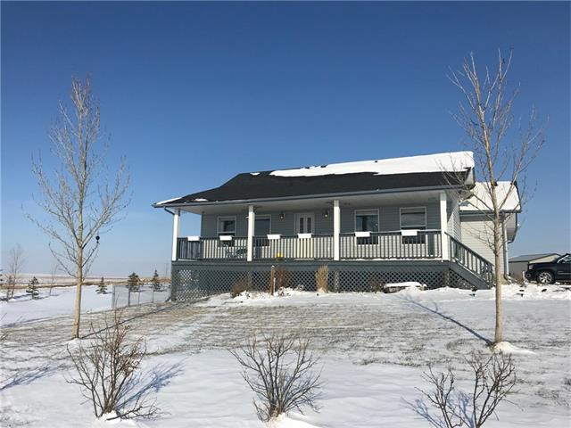 It will be hard to find a nicer or better maintained acreage under $625,000. Imagine living in this beautiful private setting with the mountain views in the distance. This home has been lovingly cared for by the current owners & it has received many upgrades. There is a new dishwasher, washer, dryer, water system, 2 new hot water tanks & new light fixtures, including under counter lighting. There are new window coverings in the living room, new wallpaper in the master & the majority of the home has new baseboards, trim & paint. There is new flooring in 3 of the bedrooms & LED lighting on the main floor. The well, septic & soft water system have all been serviced & are in good working order. There have been over 60 trees & perennials planted. Bring your toys big & small with a 24 x24 garage & shop (wired for 220) there is plenty of room. Bring the horses too there are 7 acres for them to roam. Bonus is a fenced yard, children's play set & fenced dog run.