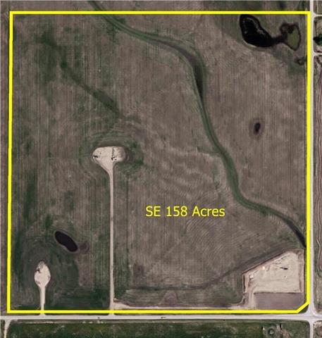 Investment Opportunity! 157.95 acres of land located close to Carstairs on the corner of Highway #580 and Range Road 14. Paved access. This land is situated within the Wessex Area Structure Plan Medium Density which allows for subdivision of the property.Great Development property, develop now or in the future. Total income for 2017 was $26,580. Adjoining land and buildings also available making it 1 section in a block