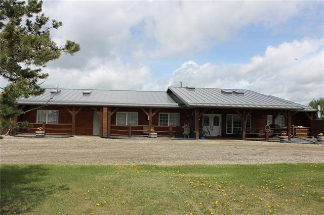 Ideal 38.82 Acres with fabulous Mountain view in a fantastic location only  11 kms North of Cochrane. Very attractive unique Rancher Bungalow that has 2519 sq ft of developed living space  with in-floor heat. You will be very impressed with the open concept living area with 12 ft high ceilings and skylights.  Kitchen with granite counter tops overlooking the large dining room and living room. Good sized master bedroom with a charming ensuite and huge walk in closet. Second and third bedrooms each have their own adjoining bathrooms, 4th large bedroom off the big family room and a nice office with massive built in desk. Bring the horses trucks trailers and toys for the 40x60 Shop. The Barn is 48x36 with 16 tie stalls with automatic waterers,   Quonset is 24x32 with a mezzanine. The property also has a large dugout and a half mile race track. Lots of pasture, pens and paddocks. This unique home is considered below grade based on RMS rules. Don't miss out come and view today. Listing Realtor is owner.