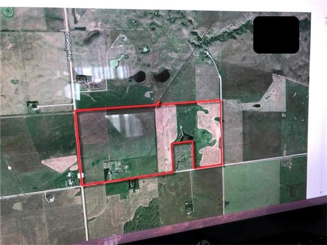 298 Acre parcel running parallel to Highway 22, approx. 4km north of Trans Canada Highway and located within the Rocky View County/Town of Cochrane Inter-municipal development plan. Ideal holding property for future residential development. Property is currently receiving nominal income from the farm buildings.