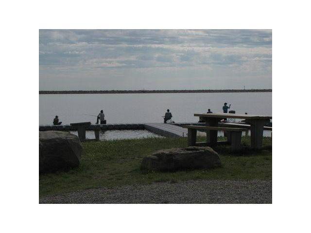 Near the Pine Coulee Reservoir, 4 miles west of Stavely.  A single family lot waiting for your ideas of a home to enjoy the lake amenities of fishing, skating etc.  The lots are GST applicable and the condo fee is for road maintenance at $100 and year.