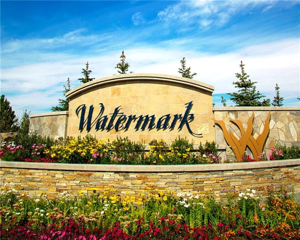 Premier .37 acre fully serviced corner lot in Phase 3 of the award-winning Watermark at Bearspaw community!  Architectural & landscaping guidelines maintain & elevate the value of the homes at Watermark. Choose from one of developers preapproved award winning builders or bring your own with developer approval. Watermark offers 46 acres of parkland; 5km of paved pathways; a central plaza with a large covered pavilion & outdoor kitchen; playgrounds; basketball court; & more! HOA fees cover front yard maintenance including weekly mowing/trimming; weekly curbside garbage/recycling pickup; snow removal on streets, pathways & central plaza; maintenance of cascading ponds, outdoor kitchen, central plaza, playgrounds; booking & use of Central Plaza for your special events! Build your dream home on the western edge of Calgary with easy access to the mountains and only 25 minutes to downtown Calgary or the airport!