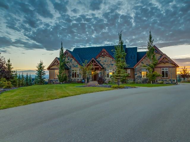 OVER 5256 sqft of CUSTOM BUILT living space, 4 CAR GARAGE + storage on 2 ACRES w/the MOST SPECTACULAR + UNOBSTRUCTED VIEWS from the PREMIER LOT in ALL of MORGANS RISE! This WALK-OUT bungalow is the DEVELOPER'S OWN HOME + PRIDE of OWNERSHIP w/NO EXPENSE SPARED + MOUNTAIN VIEWS from EVERY RM! EXCEPTIONAL QUALITY + CRAFTSMANSHIP inc TIMBER BEAMS, CUSTOM WOODWORK, MERBAU H-WOOD + SLATE flr's, CUSTOM CEILINGS, IN-FLR HEAT, GRANITE COUNTERS, MULTI-MEDIA SYSTEM INSIDE + OUT, WOOD DOOR's, A/C, U/G SPRINKLERS + MORE! INVITING Main w/OFFICE, 1/2 BATH, DINING rm + LIVING rm w/F/P + 19ft CEILING! STUNNING kitchen w/HIGH END APPLS, CUSTOM CABINETS, ISLAND + BFAST NOOK. MASTER RETREAT w/SPA-LIKE EN-SUITE w/DOUBLE VANITY + SOAKER TUB + CUSTOM BUILT W-IN CLOSET plus, 2nd BEDRM has EN-SUITE + W.IC.! Lower lvl has 2 BDRM?s, 2 BATH's, FAMILY rm w/F/P, GAMES rm, WET BAR + WINE CELLAR w/IRON GATE, THEATRE rm w/SURROUND SOUND + LRG LAUNDRY rm. EXTENSIVE LANDSCAPING w/TREES, ROCK GRDN, O/S DECK, PATIO, IRON RAILINGS + FIRE PIT!