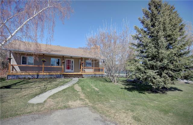 """Please click """"Multimedia"""" for 3D Tour! Amazing renovated bungalow on whisper quiet street with WEST facing backyard in a great area of Langdon! Features include: 3+2 bedrooms, huge yard - it is actually on 2 lots - 1/3 of an acre, oversized/insulated double garage with 2 storage add-ons/220V, RV parking (or room to expand garage), lots of large mature trees/bushes creating privacy, newly renovated kitchen with white soft close cupboards & drawers - important for the discerning cook or baker, vaulted ceilings, cozy wood burning fireplace, good sized bedrooms, huge bright laundry room (hook-ups on main as well), insulated basement floor, RO system, custom/cordless/energy wise honeycomb blinds & much more!  Location is fantastic - 2 blocks to Sarah Thompson School (K-5), 2 blocks from Langdon Field House & Baseball Diamonds, 2 min walk to groceries/amenities and a stress free 20-30 min drive to Calgary!  Pride in ownership and move in ready is the best way to describe this home!"""