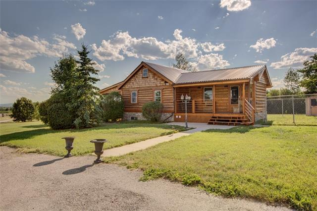 Here is an HISTORIC opportunity to own an HISTORIC acreage in the heart of South Springbank. This outstanding property right off of Springbank road offers over 18+ acres and is what History is all about. The refurbished 1887 log home with 3 bedrooms is the perfect place to live while you build your perfect dream home you have always wanted up against the trees with outstanding views of the Alberta Foothills and the Rocky Mountains. And when done it can ch be your guest house or office.This propert can be subdivided or .. There is a large Quonset that has been set up for Automobile work or can store all your farm equipment. There is a great opportunity to have an Impressive Equestrian Set-up with Level ground & Fenced Horse Pasture with Waterer. The single car garage can also be used as an office or art studio.