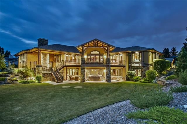 Built by Taradar Homes and perfectly positioned on a 2 acre estate with spectacular mountain views. Utilizing only the best building materials and craftsmanship, this masterpiece features over 6200SF of living space, heated garage parking for 7, and functional family and entertaining spaces. Extensive timber detail and custom millwork flow throughout the home. The main features an open plan with chef's kitchen, study, dining & great rooms as well as access to the covered deck and outdoor kitchen. The master boasts a 6 pc. ensuite and dressing room, with access to the main deck. National sporting events have taken place in the sports room complete with jumbotron, wetbar, projector, games area, woodburning fireplace and viewing area to show car garage. The bsmt features 3 beds, wine room, fitness center, second laundry and spa. Hobby enthusiasts will appreciate the shop & detached garage, while being less than 20 minutes to DT Calgary. Watch the video for more!