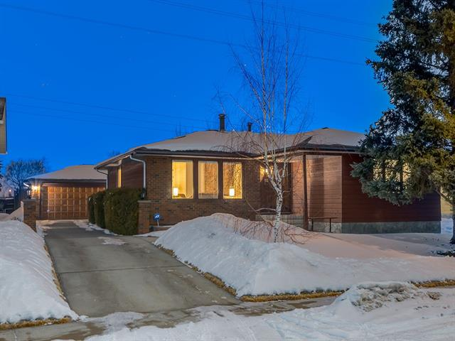 """BEAUTIFUL, 4 BDRM Bungalow w/OVER 2511 sq ft of DEVELOPED LIVING Space, FINISHED Basement, O/S 25'4"""" x 23'4"""" HEATED Double Garage w/EXTENDED Driveway, LARGE 538 sq mt LOT, DIRECTLY backing onto GREEN SPACE + Kitty CORNER to MALCOLM McCRIMMON PARK in a QUIET EASY ACCESS Location!  BRIGHT main lvl opens up to a SPACIOUS Living rm w/Corner Stone F/P, Dining rm, SUNSHINE Kitchen w/WHITE FULL Height Cabinetry + LOTS of STORAGE, Matching Appliances, BAY WINDOW over sink, B-fast NOOK, 4pc FAMILY Bath + 3 Good-sized BDRM?s incl the LRG MASTER w/2pc EN SUITE + 2 Closets!  Lower MUD rm w/shelving + GORGEOUS HARDWOOD stairs w/WOOD + METAL railing lead to the basement, which features KNOCKDOWN CEILINGS, Rec + Family rm w/CUSTOM BUILT-IN entertainment unit + BAR unit w/WINE RACK, LARGE 4th Bedroom, LUXURIOUS 4pc Bath w/JET TUB, Stand-up SHOWER, plus a FLEX/OFFICE, LAUNDRY + Utility rm w/NEWER H2O Tank + Furnace!  FULLY Landscaped Yard w/TREES + SHRUBS, Deck w/BUILT-IN PLANTERS, Close to PARKS, SCHOOLS! VIEW IT TODAY!"""