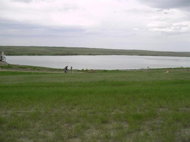 Note: Seller very motivated! An all-season resort located in Southern Alberta at one of the warmest lakes. An opportunity to build your new, retreat home with gorgeous, panoramic views of Little Bow Lake. This larger lot, measures 157 feet by 137 feet. An amazing property, which provides for a walk-out home with wonderful views of the lake, and surrounded by nature in tranquil setting. Little Bow Resort is fantastic for all water sports, including boating (with its own marina), swimming with private beach, winter ice fishing, and skating. Full services includes electricity, gas, water, and sewer to building site, water treatment plant, sewage system, telephone system, garbage removal, and high speed internet. Docks for boats, water craft and indoor storage available (storage unit needs to be purchased). On site refuelling station for water craft.  RV parking for summer guests, and Maintenance Supervisor, on site all year round. Immediate possession possible.