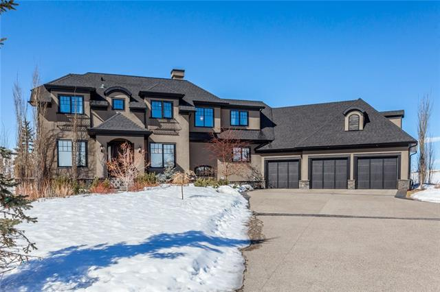 This beautiful, executive well designed & fully finished home is located in the subdivision of Grandview in Springbank.  A few of the many features of this home include, gleaming hardwood floors, rich textures of custom wood cabinetry & well designed layout.  Main floor boasts den, formal dining room, dream kitchen with center island, granite counters, gas range & eating area,  large family room with marble faced fireplace & great views,  laundry room & large mud room with access to triple attached garage.  The upper lever has large bonus room with built ins, 3 bedrooms that all have walkin closets and ensuites.  The walk out lower level has a huge rec room with fireplace, media room, 4th bedroom with ensuite.  Located on a fully landscaped 2 acre lot with gorgeous mountain views & curved exposed aggregate driveway.  This home offers so much and must be viewed to be appreciated.  11 Grandview Grove.