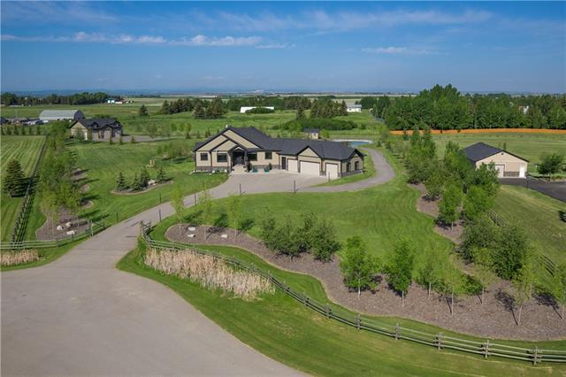 LUXURIOUS BUNGALOW W/OVER 4288 SQ FT of CUSTOM development, located on the hillside w/4.45 HORSE FRIENDLY ACRES w/INDUS AIRSTRIP ACCESS + TAXIING lane, R.V. PARKING, QUAD garage, FULLY LOADED 1514 sqft  HEATED WORKSHOP w/2 CAR LIFTS, 2pc bath, laundry + sink station! EXECUTIVE Open Concept layout features 3 FULL BATHS + 4 BDRM's incl the MASTER w/5pc EN SUITE w/SOAKER TUB + DREAM W.I.C! GRAND Foyer, WARM HARDWOOD flrs, 10 + 12' CEILINGS throughout, FRONT OFFICE, LIVING rm w/STONE GAS F/P + BUILT-INS, COFFERED CEILINGS, CORNER BAR, Dining area w/MOUNTAIN VIEWS, BEAUTIFUL Kitchen w/2-TONE Cabinetry, BRICK style B-SPLASH, HIGH END APPL's, GRANITE counters + ISLAND, WALK THRU PANTRY,  2pc bath, LRG MAIN flr LAUNDRY, MUD rm + 1/2 bath! GORGEOUS WALKOUT bsmt w/3 BDRM's, 2 additional baths, SPACIOUS Family rm w/GAS F/P, WET BAR, HUGE REC rm , Storage + Utility rm. EXTENSIVE Landscaping w/FULL Irrigation, LRG PATIO, GAZEBO, Bridge, Pond, FIRE PIT, SHED, Invisible Dog Fence, Curved stairs to the COVERED DECK! WOW!