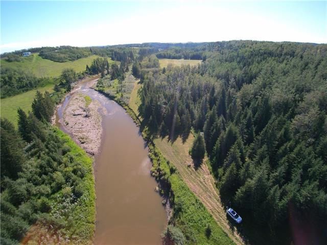 Exceptional property with 300 acres of agriculture land with highway frontage, gravel deposit plus forest with a river running though the property. 40? x 100? shop, pasture and hay land. Great building sites. Excellent future development or your own private paradise. Call Lister for more details