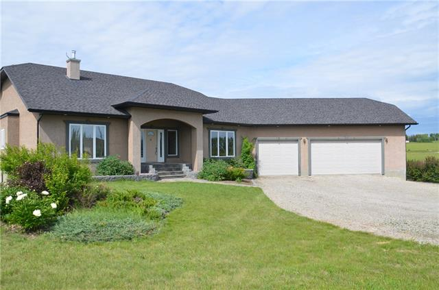"**WONDERFUL, immaculate well built walk-out bungalow with over 4500 sq. ft. of developed space BOASTS a MAGNIFICANT view of the MOUNTAINS. Huge, tiled entryway opens into this warm, inviting main area and grande stairwell. Formal dining area offers tray ceiling. Double doors open into the den area with unique ceiling. Lots of windows for natural lighting in the living area facing those great mountain views. plus built-in area for your entertainment centre. Functional kitchen with island and lots of custom cabinetry. Huge walk-through pantry area and special freezer. Big space for your washer,dryer and garage entrance plus your own ""costco"" area storage. The walk-out lower level features lots of room for entertaining with a games room, huge theatre area, rec room, exercise room plus 2 large bedrooms Lower level offers in-floor heating. Huge OVERSIZED garage is insulated, heated, and is 30.7 x 45.10 so lots of room for all your vehicles."
