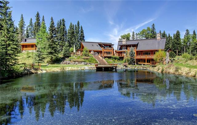 AUCTION: Bid October 23-26   Previously $5.999M CAD, Selling Without Reserve   Property Viewings: Mon-Wed by Appt & Thurs-Sun Open House 1-4pm Welcome to 352248 Pine Ridge Road, where rich wood details, log furnishings, stone accents, and astounding craftsmanship beckon at every turn. Spend your days taking in the views that greet you from every room, and welcome each morning while sipping a cup of coffee on your expansive wraparound deck. Complete with seven bedrooms, two of which have spa-like en-suites,� there is ample space for the whole family. A state-of-the art kitchen, formal dining room, 2-story great room, and wet bar ensure that entertaining has never been easier. When it?s time to retire, watch the stars come out while soaking in your outdoor tub. Here, everyone will find peace and solitude.
