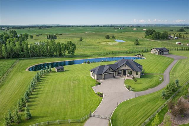 STUNNING home w/over 4199 sq ft of CUSTOM + HIGH END living space on 4.45 ACRES, ACCESS 2 INDUS AIRPORT w/PRIVATE AIR STRIP + only 30 mins to DOWNTOWN CALGARY! TRIPLE ATTACHED garage + DETACHED HEATED WORKSHOP w/built-in work benches + 4pc bath, a UNIQUE TROUT POND + WATERFALL feat, UNDERGROUND SPRINKLERS, H-WOOD flrs, CUSTOM BUILT-INS, ELECTRIC BLINDS, WINE CELLAR, 2 H20 TANKS w/re-circulation, BSMT IN-FLR HEAT, 10 ft + 12' ceilings + more! IMPRESSIVE PAVED driveway welcomes you to the front porch + OPEN CONCEPT main w/office, living rm w/COZY GAS F/P + GOURMET kitchen w/GAS COUNTER TOP STOVE, GRANITE COUNTERS + ISLAND, WALL OVEN, CREAM COUNTRY STYLE cabinetry + WALK-THRU PANTRY! Dining area w/access to HUGE DECK w/STUNNING VW's over the acreage! HANDY laundry/mud rm, half bath + LRG main flr MASTER featuring a 5pc EN-SUITE + W.I.C! Lower Lvl has HUGE family/rec rm w/WINE CELLAR + WET BAR, EXERCISE rm, 3pc bath, 2 GOOD SIZED bdrm's + WALKS-OUT to BIG PATIO w/SPIRAL STAIRCASE to upper deck! SPECTACULAR!!!