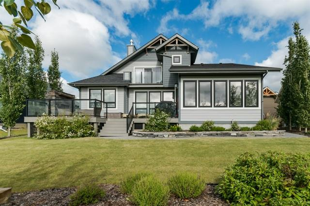 LAKE LIVING AT ITS FINEST!  This stunning & exceptionally well-designed property is ideally suited for usage as a year-round vacation home, or permanent lakeside residence. Providing over 2500 sq.ft. of bright, spacious and incredibly comfortable living space, you have the ability to host large family gatherings, and enjoy restful & cozy family time together. The home?s open concept design & abundance of windows provides a ton of natural light throughout, as well as panoramic views of the lake & reserve area.  The custom 3 bedroom | 2.5 bath + loft design is equally exceptional outside w/ its gorgeous Prairie-inspired elevation, wrap-around deck & professionally landscaped yard. The oversized single detached garage is perfect for both vehicle & lake toy storage, and both BOAT SLIP and 10 yr NHW are included. The large west-backing yard includes an expansive deck w/ gas fireplace & private upper deck off the master bedroom, ideal for enjoying Gull Lake's spectacular sunsets from. Simply move in & enjoy!