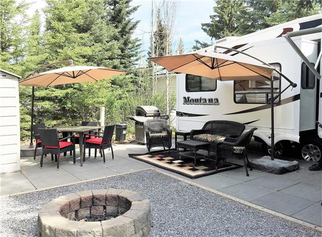 WITH OR WITHOUT!  Purchase the lot alone or with a top of the line 2008 34' Montana 5th wheel on a beautifully treed yet sunny lot. This quiet and private lot is close to the river trails, parks and playground. Nicely landscaped with areas for visiting, cooking or sitting around the fire! Single bedroom unit with beautiful layout and modern decor. It?s one of the nicest available in the park! And what a park! Tall Timber Leisure Park features low condo fees that include seasonal water, sewer, power, garbage, satellite, wifi hotspots, gated entrance, onsite management, showers, bathrooms, owners lounge and more!! Also included is use of the many amenities including the indoor swimming pool, hot tub, modern playgrounds and parks! Located on the Banks of the Red Deer River this is sure to be an oasis for your family every year!  Lot only $58,900, with the 5th wheel $95,000.