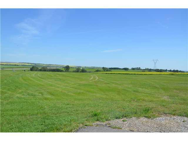 Pastoral views from this super raw land parcel ideal to build your dream home with a full walk-out basement as the land slopes to the south. This 4.3 acre parcel is ideal for your horses. Choose your own builder. Excellent well at 7.5 GPM. Gas and power to the property line. Paved roads. Architectural controls are in place to protect the integrity of the subdivision. Only minutes from Okotoks, golfing, shopping and schools.
