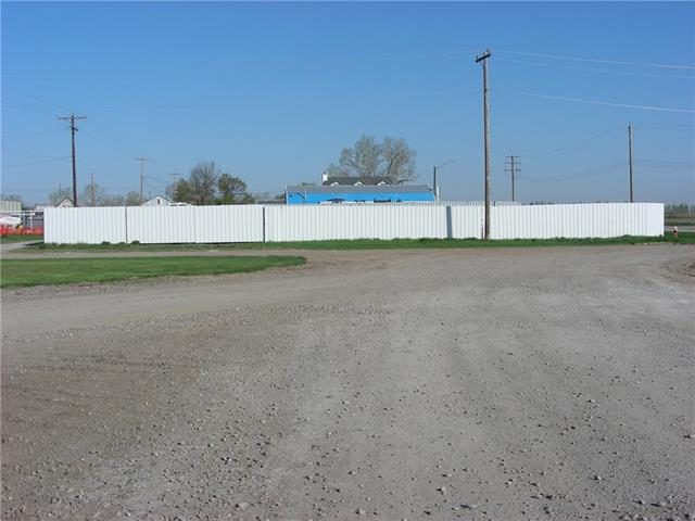 Commercial lot in Blackie metal fencing on all sides.  Blackie is 20 minutes  east of High River. Great place to build your  business or someone in need of a secure site for storage. This would be a good place for a landscaping company, lot is nice and flat and is on a  corner so has good access. Great price on a commercial  lot of this size, lot is 11,965 square feet.
