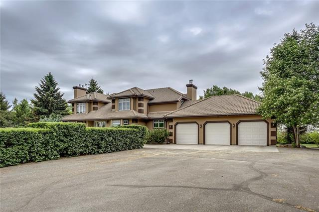 An extraordinary opportunity to own this luxury estate bordering raw 80 acres annexed by the Town of Strathmore (MLS C4188280). The security gate leads to a tree lined paved driveway to this luxury executive home, presented in absolutely pristine condition. The home features gorgeous design, high end finishes, warm tones & spacious layouts, perfect for family living. Entertain in the receiving room, formal dining area, chefs kitchen or the full width no-maintenance deck. Play in the rec room with wet bar, sunken indoor hot tub & tv/theatre area. Enjoy hobbies in the covered sunroom or the sensational shop (5000 SqFt). The manicured grounds offer full irrigation, dedicated garden plots, gorgeous tall trees & beautiful blossoming foliage and ornate shrubs. Extremely private, yet ideally close to Strathmore or routes to Calgary. This property offers superb investment and future development opportunity. A truly rare opportunity! Please see additional remarks and supplemental documents for additional features.