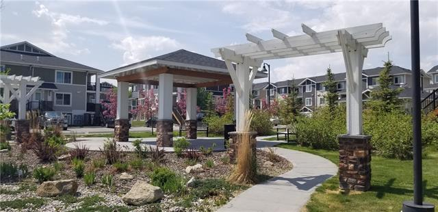 Fantastic 2 bedroom main floor condo located in desirable Chestermere Station. This main floor (just a few steps below grade), open concept, corner unit with large windows and large island is ready to move in, or alternatively to have as a fully managed investment property with management in place. Built in 2012 this condo shows very well with neutral paint colours, in suite laundry w extra space for storage. Assigned parking with potential to rent additional stalls and low condo fees of under 160 dollars a month make this a great starter home or investment property. The condo is just around the corner from a shopping area with groceries, restaurants and anything else you may need as well as steps away from the lake and paths making it a perfect location. An easy drive to Calgary via 16th Ave or 17th Ave in the NE. The complex allows pets; you may have up to 2 cats or 2 dogs or 1 of each and kids are just fine too. Call your favourite Realtor to book your showing today!