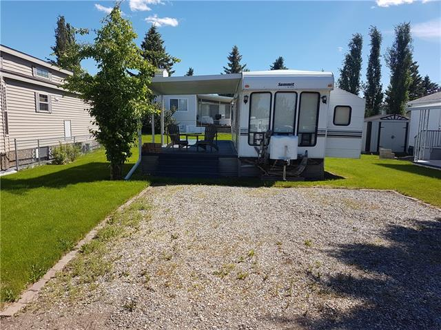 Excellent location just steps from the Marina in Phase III.  Nice open lot a very large deck half covered with a metal awning for a graet sun/shade mix.  This spacious 40', 1 bedroom trailer with 2 slides has a queen bed and hide-a-bed in the living room.  Full sized fridge, stove, microwave and double sink.