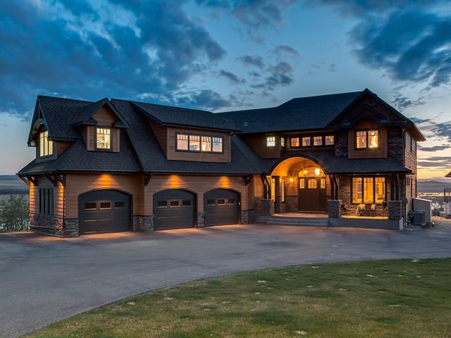 BEAUTIFUL CUSTOM BUILT HOME w/7219 sqft living space on 3.76 acres on RED DEER LAKE, w/BREATH TAKING MOUNTAIN VIEWS + HIGH END CRAFTSMANSHIP! CLOSE to the NEW GRANARY ROAD Farmers Market! TRIPLE garage + TRIPLE WORKSHOP w/918 sqft upstairs, HAYLEY CABINETS + CAR LIFT. 25 ft SLATE WATERFALL, OPEN RISER stairs, $125k AUTOMATION system, WIDE PLANK WALNUT, SLATE + CONCRETE floors, IN-FLOOR + BOILER HEAT system, 2 AC units + more! GRAND foyer, FORMAL living rm, office w/WALNUT BUILT-INS, family rm w/GAS F/P + TV HIDDEN BEHIND ARTWORK, dining rm w/TIN CEILING + DREAM KITCHEN w/GRANITE w/MOTHER OF PEARL, BUTLER PANTRY + WOLF, BOSCH + SUB-ZERO appls inc 6 BURNER GAS STOVE! Upstairs a HUGE BONUS RM area + 4 BEDS inc the Master Suite w/BARRELED ceiling, EN-SUITE w/SLIPPER TUB, DUAL GLASS SINKS + WALK-IN CLOSET! Downstairs a MEDIA RM w/PROJECTOR, WET BAR w/CONCRETE COUNTERS, bathroom w/STEAM SHOWER, family rm + 5th BEDROOM! WRAP AROUND DECK, STAMPED CONCRETE PATIO, OUTDOOR HOCKEY RINK + $175k spent on landscaping!