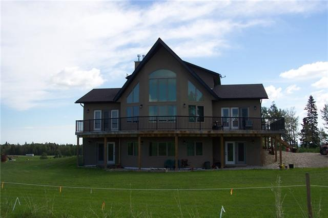 Opportunity knocking..90 acres with 2 homes, corrals, quanset & outbuildings.  The new 1 1/2 story fully developed walk out, 6 bedroom home was built in 2014.  Features of the main floor include, vaulted ceilings, gleaming hardwood floors, huge kitchen & eating area, living rm with rock wood burning fireplace, massive windows to the west & mountain views, main floor master suite with 5 pc. ensuite, 2nd bedrm, 3pc. bathrm & laundry rm.  The upper level has 2 bedrms & 4 pc. bathrm.  The lower walk out level has 3 bedrms, 4 pc. bathrm & family rm with wood burning stove.  Boiler system with inslab heating.  There is a full wrap around deck.  Second home is 1000 sq ft & is presently rented for $1100/month.  Out buildings include 32x64 Cow barn, Pole storage 32x64, horse barn with 3 stalls 32x60 & shop 32x48.  There are corrals, 2 waters, 2 dugouts, great combination of trees & open area.  Located 1/2 mile east of Water Valley Golf course on paved road.  Great opportunity for any stock operation you may want.