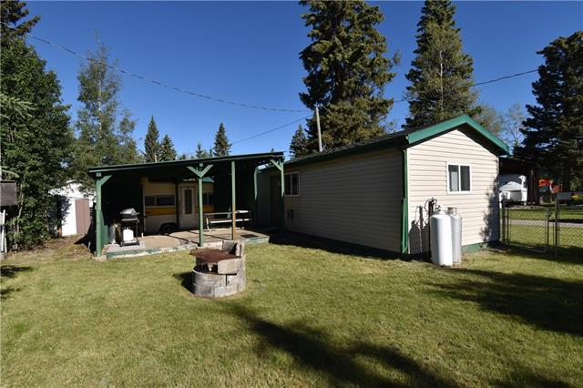 Quaint cottage located in Clear Springs Private Campground, west of Caroline, AB. Excellent opportunity to have your own private recreational property in the heart of the WESTCOUNTRY. 1 of the few fully serviced lots in the campground - power (15 Amp, 2 breaker), water, & a 1000 gal septic holding tank. Fully fenced with a small cottage (32x12), a custom built covered deck & a 13x10 Vanguard travel trailer built into the deck for additional accommodations. The cottage offers 1 bedroom, kitchen/living room with a bonus area for storage & a 2 piece bathroom. Conveniently located directly across the road from the common shower house & playground. The campground offers a private 9 hole golf course, ability to stage directly from your site (with restrictions). 99 year lease agreement, 85 years remaining (expires April 30, 2103). There are 124 leased lots throughout the campground, no seasonal lots are available. This is a private recreational camping facility.