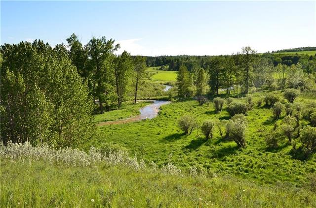 So much opportunity with this spectacular full quarter section with mountain vistas. Located between Cochrane and Cremona just West of highway 22 on top of the Bottrel hill. This 160 acres is fenced and  features two crop fields, a pasture area, plenty of trees, and the Dogpound creek flowing through. Currently there is a developed natural spring flowing that produces 20-30 gallons of water per minute. This quarter has it ALL!!! An ideal set up for building, a ranch, subdivision, or other agriculture/business use. Utilities are at the property line. Land is currently being leased for crops and grazing.