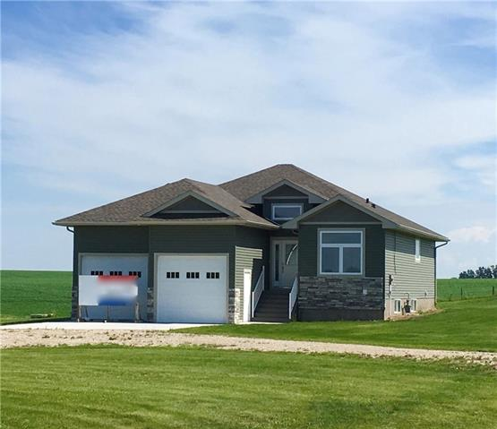 Are you seeking the acreage close to town? This is the right home for you, located minutes from Olds. This 1500+ sq ft 5 bdrm brand new home features many upgrades. Step into the bright front entry, and make your way to the open concept living/dining/kitchen. You will love the vaulted ceilings, great working space, gas fireplace and access to the rear, partially covered deck. Main floor also features a large master bdrm, with a great ensuite and walk-in closet, as well as 2nd bdrm and main bath. Downstairs, the heated floors will keep you toasty in cooler weather. Enjoy the additional 3 bdrms, large family room, storage and 4pc bath. For the toys and cars, there is a large attached double garage, complete with insulation and drywall. All this is on 1.45 acres, which have planted trees and seeded grass is waiting for your family to come home!