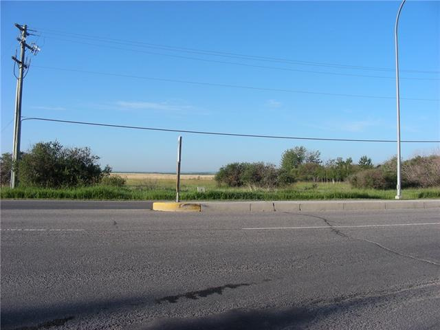 Fantastic location, Hy-Way frontage  right off of  Hy-Way 23 Less than a kilometer from hy-way 2 .  This 67.68 acres parcel of land is  right in the Town of High River. Huge potential for this parcel with approximately 265 meters of fronting on to the bustiest Street/Hy-Way  in High River. This land is one of the first pieces of  land as you come off the overpass into High River. If you are looking for an opportunity to develop this parcel of land, the sky is the limit.  High River is a bustling community just 25 minutes south of Calgary that is currently go through a growing phase. The Town of High River has one of the most progressive Land Use By-Law in Alberta.