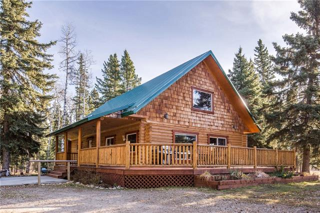 """CUSTOM BUILT LOG CABIN ON HOBBY FARM! This stunning 8 acre is located in the midst of quarter & half sections.This gives this piece of paradise the ability to be private but not isolated.Only 16 mins to the town of Sundre & 1 hr to Calgary city limits,this is the rural living many have been looking for.Inside the custom built log cabin you have an open lofted concept.At the time of build many additional upgrades were complete; interior walls all insulated for sound dampening, upgraded windows, 3/4 inch sub-floor, 16"""" on center joists & a rough in for additional heating source.The cross fenced set up is already done for you.In this park like set up it has a great mixture of forest & pasture, a pond for seasonal fish or a duck habitat.Large decks to enjoy those hot sunny days.There is even a portion the current owners call 'the camp site where friends and family can pull up their RVs for a visit. The greenhouse enables you to garden nearly all year round."""