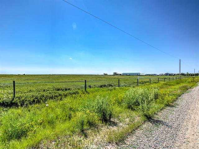 CLEAR VIEWS ALL AROUND,  beautiful location. Raw land waiting for you to make that Dream home Acreage come true. Take a drive today and check it out. 10 minutes away from Strathmore and quick access to 22x for those commuters.Hwy #1 at Strathmore , turn at Husky Gas Station South on secondary Hwy # 817, Turn East on Namaka Road (paved) Township Rd 232. Turn on Range Road 250 - North, Property in on the East side of road, about 1/2 mile.