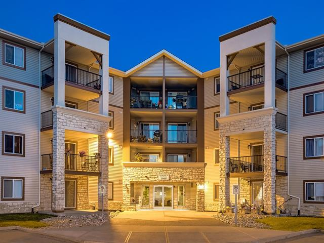 SUPER CUTE 2 bedroom condo w/OVER 989 sq ft of DEVELOPED LIVING SPACE in the POINTE at COCHRANE complex! INCREDIBLE VALUE here + TONS of features you will LOVE including CLEAN, BRIGHT + MOVE-IN READY, NEUTRAL DECOR, SPACIOUS LAYOUT including IN-SUITE STORAGE, IN-SUITE LAUNDRY, GREAT COVERED CORNER BALCONY, TITLED HEATED UNDERGROUND PARKING STALL + FRESHLY PAINTED!!! The WELCOMING Entrance has a closet, STORAGE rm + LAUNDRY rm + leads to the OPEN CONCEPT Dining area, LOVELY Kitchen w/2 tiered BAR COUNTER, WINDOWS over the sink, tiled back splash, PLENTY of cabinetry + MATCHING Black appliances! The LARGE Living room has doors leading to the BALCONY w/VIEWS over the complex + ROLLING hills beyond! 4 pc Main bath has TILE flooring + 2 GREAT SIZED Bdrm's including a LARGE Master w/WALK-THRU closet leading to the 4 pc En-suite! CLOSE to COCHRANE'S MANY SHOPS, BARS + RESTAURANTS + QUICK ACCESS to BOW VALLEY TRAIL to get to CALGARY - FAST! AMAZING VALUE, a GREAT BUY, DON'T MISS OUT ON THIS - IT'S A MUST VIEW!!!