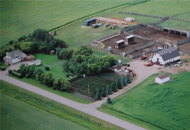 UNIQUE PURCHASE OPPORTUNITY!!! 76.98 ACRES OF BEAUTIFUL PASTURE HOBBY FARM LAND + RESIDENCE W/OVER 2628 SQ FT of living space w/Partially developed BSMT, fully landscaped w/IRRIGATION system for OVER 150 Saskatoon trees + Bushes, HEATED 5 STALL BARN equipped w/HOT + COLD water, Kennel area, Tack rm + Flex space, LARGE WATER HOUSE, 4 SHEDS, WORKSHOP + GREENHOUSE!! MAJOR RENO's in 1976, this SPANISH INSPIRED House features NEW WINDOWS, BIG COVERED PORCH, spacious Living rm w/GAS F/P WET BAR, Semi-Private Dining rm across from BRIGHT Kitchen, 4 pc bath + MAIN floor BDRM w/dual closets, HUGE MUD ROOM w/access to back Porch + MASSIVE DECK! Spiral Stairs lead to the UPPER w/2 GENEROUS bdrm?s, both w/PRIVATE BALCONIES; Master w/Attic storage + 4 pc Family bath. Partially developed BASEMENT features a FAMILY rm, Large Laundry + Utility rm, BIG storage rm; PERFECT for 2nd WORKSHOP, 3 pc bath + separate SAUNA ROOM! Properties like this DO NOT come up often! ONE OF A KIND! Great OPPORTUNITY for the RIGHT BUYER!!!
