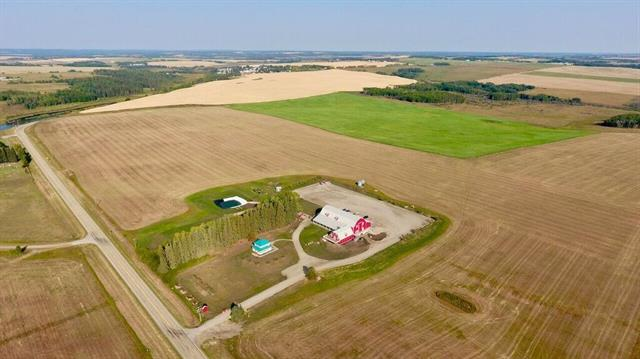 Looking for a great 1/4 section to farm yourself or hold onto and lease out? 148.57 acres just 1 mile East of Cremona on Hwy 580. This productive parcel borders the popular new MVE The Heritage Centre. Located on a paved road less than 1 hour from Calgary and only 30 minutes to Cochrane! Listing is the land only, buildings are part of a separate subdivision.