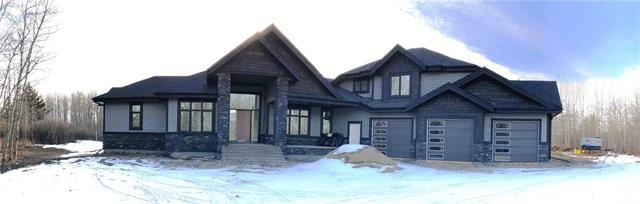 If you have been waiting for an exquisite new build in this community this is a must view. You can watch the progress of your new home as it is being created. This absolutely stunning 1.5 storey will be move in ready with the driveway paved & the landscaping complete. Drive through the electric gate to your private oasis. Notice the oversized triple heated (in slab heat) garage, covered front porch & gorgeous windows to take advantage of the views in every direction. This unique layout will works well for the couple that wants room to entertain or the large family that requires a separate wing for the kids. With bedrooms & full bathrooms on every level it will also work for extended families. The foyer is bright & inviting & makes a grand statement that sets the tone for the rest of the home. You will immediately fall in love with the soaring ceilings & feature fireplace in the living room. Make your way to the chef inspired kitchen, complete with commercial series Jenn-Air appliances.
