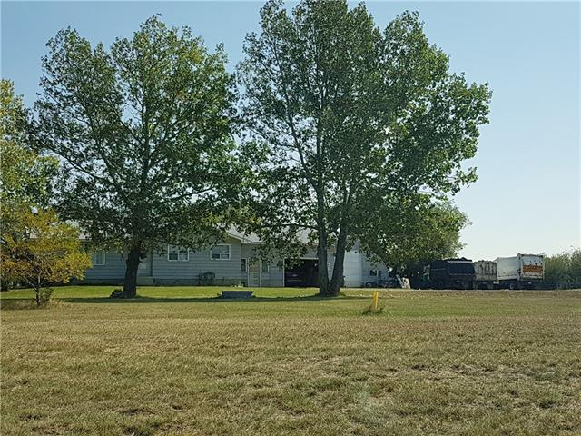 14.56 Acres for Sale, Great Location. The Property split into 2 parcels divided by Dwight Mclellan Trial. There is house on West Parcel and East Parcel is vacant, Ideal for Light Manufacturing and many other uses under Zone DC99.