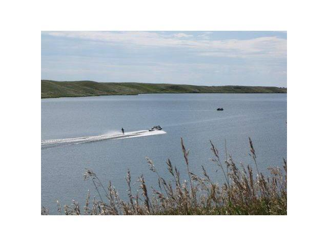 3.95 acres to build on.  A great location for boating and fishing.  I have seen water skiers on the lake too. The Government boat launch is south of the lots about 1/2 mile and the lake is a little walk from these lots .  Buld you dream home or cottage w permits form the MD of Willowcreek in Claresholm.  Enjoy Alberta at it's best being in the country.  Use a builder of your choice and when you wish.  The lots are set up under a condominium to govern the sub-division Owners to manage their interior road.  A fee of $100 will be charged for the road maintenance costs.  Each lot is title separately only the road is condo as well as it allows for architectural guide lines for the homes which the board of the condo will administer.  Sweeping views and build when you wish!  Permits w/MD Willowecreek