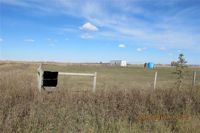 Property is 3 km north of Blackie, Alberta. Land is fenced with smooth wire for horses. There are two wells; one artisian well, 1 drilled well (flows when valve is opened). Owner is not sure of the rate or depth of the drilled well - will have 'to be determined' by buyer. Metal (Sea Can) is on site for storage and is negotiable with purchase. Power has been taken into the property to the well site.