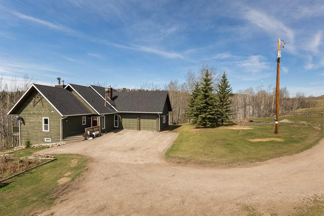 Privacy & serenity, just a couple of words to describe this unbelievable property. There really is nothing like it. Take a 30 minute drive from Calgary to one of the most beautiful locations in Alberta. The Rocky Mountains, trees & sunsets are just a few of the picturesque views you will find on this land. There is also a unique home with a main floor master, newer windows, deck & shingles & a walk-out basement. As you enter the home you will notice the newer paint, moldings, flooring & views from every window. The wood burning fireplace, private office, massive laundry room & master retreat with 5 pc ensuite & walk-in closet are just a few of the features you must view in person. Bring the horses, dogs, sheep & toys big & small, this property is all set up. The barn is placed perfectly on the land to conveniently enjoy your critters. Ensure you allow enough time to truly enjoy this location. Bring your walking shoes & stroll through the trees & pasture. This is the only way to appreciate your new home.