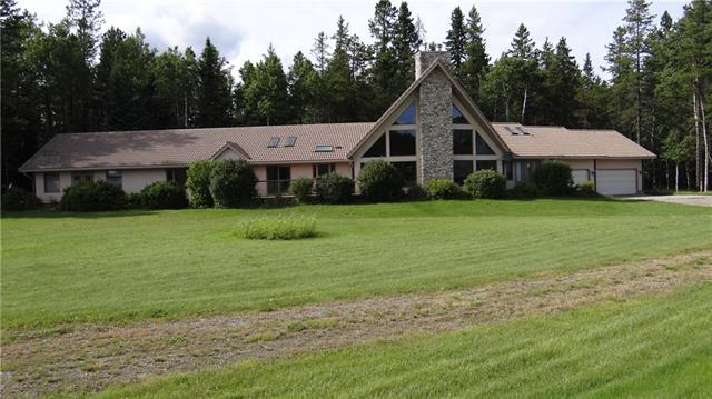 Come and see this house and acreage at your convenience with lots of potential for different options. This property has the potential, pending approval, to facilitate a wide variety of recreational and commercial interests. This is a very nice private 26.5 acres with a great mix of pasture and trees backing onto Perenaud Wilderness Park. The attached garages and outbuildings are all heated accept for the small garden equipment storage shop. All developments are done with permits and final inspections, comes with updated RPR. Paved road all the way to the property. The walk out basement is fully finished with five bedrooms and five en-suite bathrooms with permits and final inspections. Please review supplements on the listing.