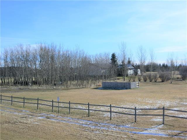 Are you looking for some peace & quiet in the country? Still want to be close to town & easy, paved access to Hwy 2 for commuting or travelling? Here is a perfect acreage in Tanglewood Acres, just off the Westcott Road between Didsbury and Carstairs. With almost 2 acres this property has room for everyone. Features outside include a firepit nestled in the trees, hot tub in covered, 16x24 curtained patio, 2 canvas shops for hiding unsightly projects & nice wood rail fence. The home is almost 1700sf with a large master suite including dual walk-in closets and corner tub in the ensuite. The living room is huge with potential to separate into multiple spaces. This opens nicely to the kitchen/dining room that has lots of space for everyone and everything! There 2 more bedrooms and a full bathroom up here. The basement is partly finished with exterior walls insulated and drywalled, cold room and utility rooms. Now the GARAGE! It's 26x28 with 11' ceilings, 10x16 overhead door and is insulated and drywalled.