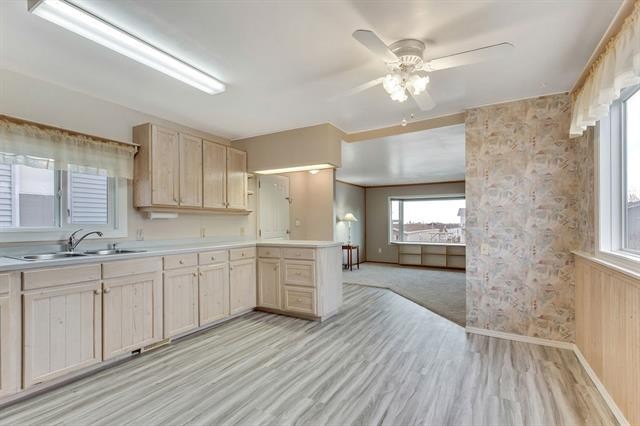 INCREDIBLE VALUE AT $147500! NO Pad fees with room to park your RV and your boat and still have room to build a double garage AND have a garden and yard to play in. This sweet home is bright, clean and a few of the recent upgrades are new vinyl windows (2014), furnace (2013), H2O tank(2018), siding and composite deck (2007), new kitchen cupboards(2007), new fridge and stove(2017), vinyl plank and carpet (2018), new screen door(2017). As you can see, it is almost new again! Large Bay window in the South facing living room allows light to stream in and flow through to the open concept kitchen. Hunter Douglas blinds & Central Air Cond?n will keep you cool in summer after you retire from the large deck and yard. No front sidewalk makes this a perfect summer retreat for snowbirds to enjoy and then fly away with no snow maintenance required. Cayley School is around the corner and a short drive to High River where there are many amenities, including great shopping, golf, hospital and rec facilities.