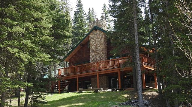 """Tucked back in the trees of Square Butte Ranch sits this modern, rustic, 1718 sq ft logsided cabin. Located on a 1.87 ac with 375 acres of Common property and direct access to Kananaskis Country for quad or horseback riding. Square Butte is a unique """"Old West"""" Townscape, with Hitching posts, Saloon, Barn, Corrals, outdoor arena, pastures, all as a part of the common area, and full care management available, allowing horse ownership, with of lock the door, pack up and leave, condo lifestyle. As you walk in the fully upgraded cabin, the cozy, warmth and feel of the 2 wood burning fireplaces melts away the stresses of everyday life. Wide open floor plan, massive stone hearth, unique one piece spiral staircase to open loft, or downstairs walkout Rec room. Escape to the spacious Master with a huge vaulted ceiling, featuring spa like ensuite with a classic claw tub and Swedish Steam shower. Come ride or belly up to the Saloon in Square Butte Ranch."""