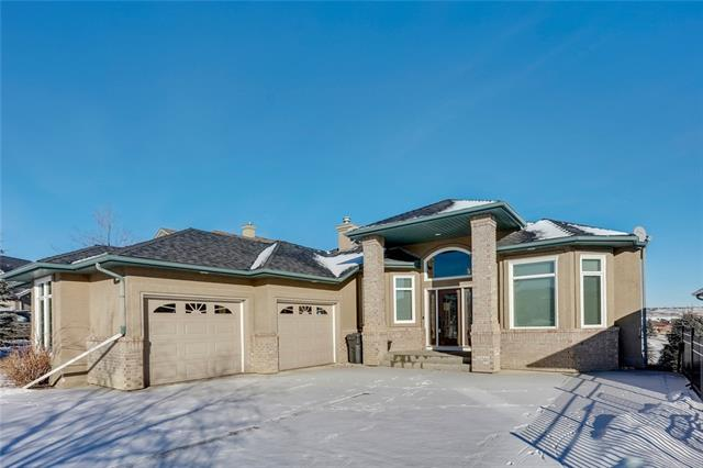 Backing onto Springbank Links golf course, this spacious bungalow is sure to impress!  This open floor plan home with high ceilings feels larger than the actual 3,795 square feet of total living space.  A separate dining room is perfect for those formal dinners or you can utilize the eat-in kitchen with breakfast nook that leads straight out to the deck.  From the deck you can enjoy views of the golf course, pond, downtown, and Canada Olympic Park. Large master suite with 5 piece ensuite, walk-in closet, and a door directly to the deck.  The main level also has a full home office with built-ins and a laundry room.  2 more bedrooms on the lower walk-out level, open rec room with pool table, bar, and plenty of room for a separate tv area.  This home has had all new windows and skylights installed.