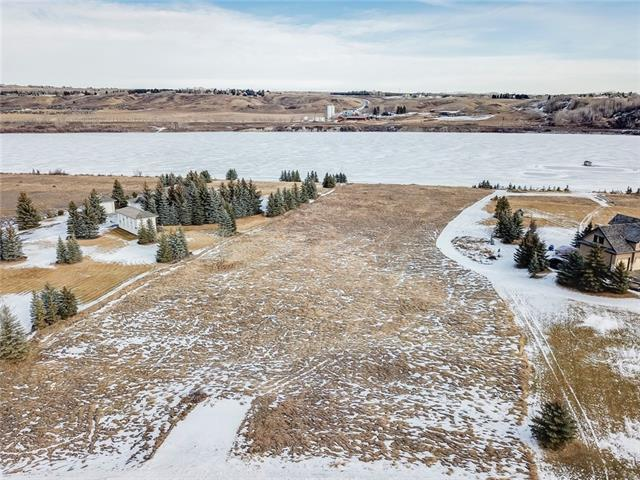 Here is your opportunity to build water front on the Bearspaw Reservoir where you will enjoy your own private marina, complete with launching ramp and dock. Waterskiing, boating, fishing, skating, sledding, and quading all can be enjoyed with direct access from this 2 acre lot.  The possibilities are endless on the home you can build here, in fact, drive around the neighbourhood and you'll be awestruck with some of the homes that surround you. This exclusive Springbank neighbourhood has close proximity to Schools and the Springbank Airport, not to mention the Springbank Links Golf & Country Club just up the hill.
