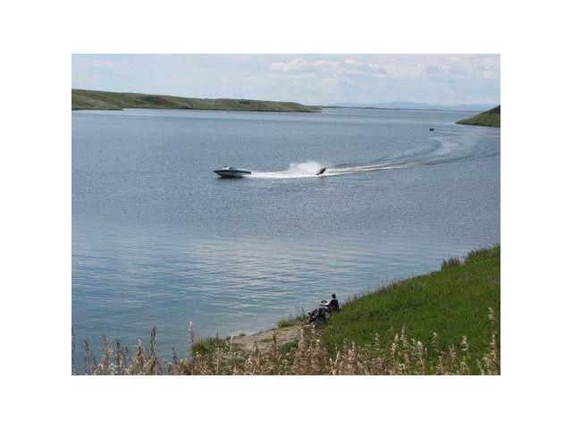 A place to make memories at a Country Property.  R1zoning to build your dream place near a lake to enjoy the country atmosphere. Swimming and boating on the lake, many water ski. fishing all year around!  no rush to build, architectural controls available on request.  Condo development as the development has control of the road.  Fees have been decided at $100 a YEAR for maintenance.  Call for details of this project a 4.1 acre parcel for $60,000 is a good price, plus gst.