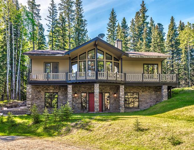 ABSOLUTLEY STUNNING Country Estate. With over 3000 sq' custom living space w/ additional 1300 sq? of potential carriage house over the garage, this home has it all!  Sunny location and situated on 2 acres, in beautiful Bragg Creek. You are surrounded by miles of hiking paths, wildlife and all that nature has to offer. Featuring high ceilings, in floor heating, hardwood, ceramic tile and walls of windows to bring in the natural light. Spacious kitchen with island and eating bar, stainless steel appliances, formal dining, step down living room with a fantastic two sided fireplace. All this within steps of the beautiful deck. The spiral staircase leads you down to the family room, pool table games room, with grand ceilings and heated tile floors. The master suite is large and bright with a brand new, luxurious spa like ensuite with glass shower. Second bedroom on main floor and the games room can easily be converted to a third bedroom. This home is a must to view, dont miss this incredible opportunity.